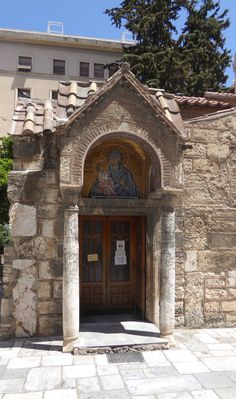 The Church of Panagia Kapnikarea is a Greek Orthodox church one of the oldest churches in Athens. Built some time in the 11th century, perhaps around 1050. Built over an ancient Greek pagan temple dedicated to the worship of a goddess, possibly Athena or Demeter. When King Otto I King of the Kingdom of Greece brought the Bavarian architect Leo von Klenze to draw the new city plan of Athens, the church was considered for demolition and it was the King of Bavaria, Ludwig I who saved the… Entrance Ways, 11th Century, Athens Greece, New City, Birds In Flight, Facade, Cathedral, Exterior, Stock Photos