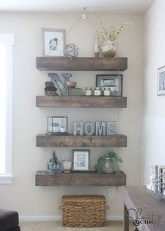 Free plans and video tutorial to create these really awesome DIY floating shelves! They use pulleys and rope to give them a cool hanging look!