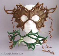 Forest Bird Duet Masks. Layered leather masks, shown next to each other.  © 2008 Andrea Adams/beadmask.com