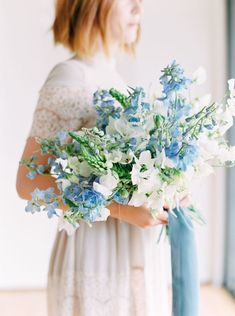Wedding film photography image of a Bride with white and green bouquet with blue delphinium and blue ribbons, Cavin Elizabeth Photography and Organic Flora, blue and white bouquet, fine art bride, dre Wedding Flower Guide, Spring Wedding Flowers, White Wedding Bouquets, Wedding Flower Inspiration, Wedding Flower Arrangements, Bride Bouquets, Wedding Centerpieces, Floral Wedding, Floral Arrangements