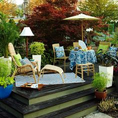 Eye-catching patterns are an easy and inexpensive way to dress up basic patio furniture. More patio perk ups: http://www.bhg.com/home-improvement/patio/24-patio-perk-ups/?socsrc=bhgpin031413patternpillows