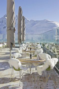 Hotel Muottas Muragl in the Swiss Alps...how amazing....I want to go there just to sit in those chairs!!!