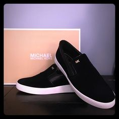 Michael kors black sneakers Black Michael Kors sneakers, worn one time to the store. Size 7 1/2 with box. Make offer. Michael Kors Shoes
