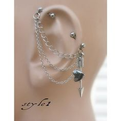An industrial piercing with an arrow and cute heart. on The Fashion... ❤ liked on Polyvore featuring piercings