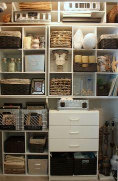 cheap closet organizing - this is a closet that organizes home decor stuff - now that's my idea of a storage closet!