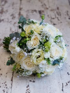 Here are some photos of beautiful wedding flowers we supplied today, the bride went for a bouquet in shades of white and green, including freesia, avalanche roses, lisianthus, gyp, eucalyptus and pearls. The bridesmaids bouquets were shades of blue and lilac, including roses, lisianthus, freesia, scabiosa and lavender. What do you guys think of the colour scheme? #reidsflorists #weddingflowers #bridalbouquet #bluewedding