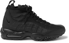 These 'Air Max 95' shoes are the latest style in Nike 's cult sneakerboot line. Ideal for long days on your feet, they have the lightweight feel of a runner combined with a utilitarian silhouette. This all-black design is crafted from leather, mesh and canvas and detailed with insulating neoprene sleeves that zip up over the tongues. Fits small to size. Take a half size larger than normal Black leather, canvas and mesh Pull tabs, zipped neoprene tongue covers, designer emblems, Air Sole…