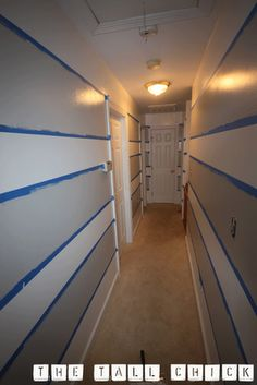 awesome tutorial on how to paint stripes on wall...step by step.