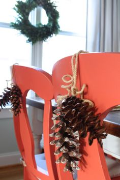 Tie pine cones to the backs of dining chairs...better yet, Snow frosted pine cones...better yet GLITTER!!