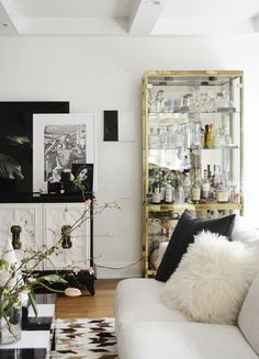 Nicole Cohen of Sketch42′s House Tour REFRESH: Before & Afters!! | Rue Love gold bookcase