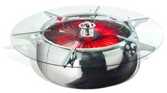 The jumbo jet conference table, made from a 747's engine nacelle and a B-52's engine spinner.