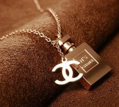.super fresh and unique chanel No. 5 Perfume Bottle Solid Chunky Silver Necklace Charm that offsets the more delicate and always classic Chanel logo, worn on a long silver-chain link necklace and paired to perfection with pretty much any outfit you can imagine wearing - very versatile piece