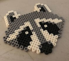 A personal favorite from my Etsy shop https://www.etsy.com/listing/584757019/raccoon-perler-beads