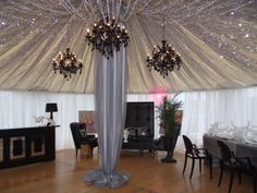 These black chandeliers matched perfectly with the drape and crystals creating the perfect lounge space!