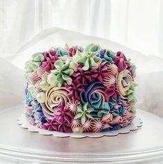@bakerp_ created this beautiful buttercream cake using a variety of star and round tips and some stunning color combinations! You can…