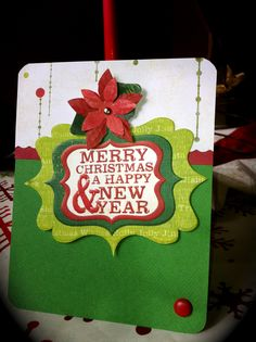 1 of the million cards I made this year... of course I used all We R Memory Keepers stuff: Peppermint Twist is the collection, corner chomper & the twist trimmer helped... I LOVE their stuff!