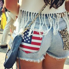 frayed cut off Jean shorts with the patriotic patch and cheetahs on the other side. Hello Memorial Day & Race day!