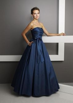 Have this in all different colors. Draped, strapless bodice with a natural waistline meets the ball gown  skirt withside pockets. Please View the Taffeta Swatch Card for Color