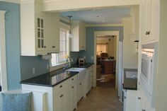 Blue kitchen walls~ Exactly what I want. Dark counters/white cabinets. blue walls