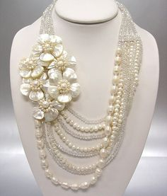 Love the different textures of pearls for each strand. Cream Shell Flowers Pearl Necklace