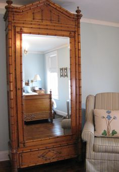 Antique French, bird's-eye maple, faux-bamboo armoire.