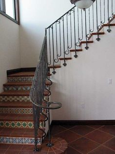 really love the tiles >> Custom Made Hand-Forged Spanish Revival Stair Railing, Side-mounted Clover motif. by David Browne Metal Design Stair Decor, Iron Railings Outdoor, Tiled Staircase, Spanish House, Spanish Style Homes, Stair Railing, Stairs Design, Iron Railing, Stairs