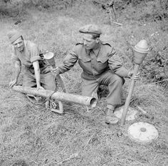 British troops pose with captured German infantry anti-tank weapons. The Panzerschreck was based on the American bazooka. The sergeant is holding two versions of the more effective Panzerfaust single-shot  weapon. By his feet are two Teller mines.