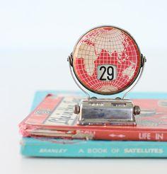 Vintage globe perpetual calendar.
