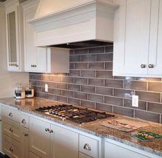 Kitchen Backsplash Grey Subway Tile ice glass kitchen backsplash white cabinets,mahogany table, blue