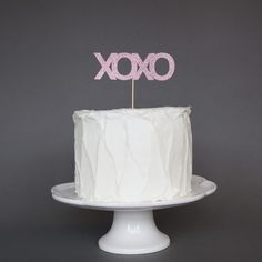 XOXO Cake Topper from thesprinklesisters.com $10