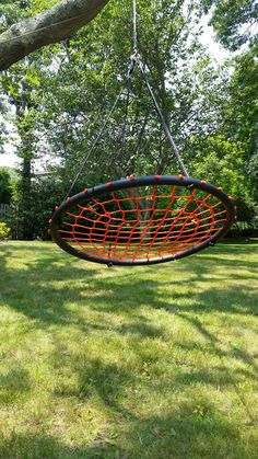 """Amazon.com: Tree Swing Giant 40"""" Spider Web Net Swing, Orange - Swing with Friends, Nylon Rope with Padded Steel Frame, Tree Swing, Children's Swing, Easy Installation: Toys & Games"""