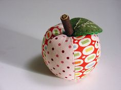 apple pincushion tutorial. I'm sure many of you have thought of making your own fruity pincushion but do not readily have a pattern. Well, now you can create all the apple pincushions you desire by developing your very own pattern with this apple pincushion tutorial. That's right, your very own pattern, so you don't have to worry about plagiarizing another's design. Check it out.