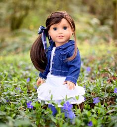 Grace found a patch of pretty purple flowers. They're just starting he right size. ☺️ #famousdolls #loveag #adultdollcollector #joy2everygirl #agig #agdoll #aggoty #gracethomas #americangirldoll #americangirlbrand