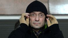 Suleyman Kerimov with black hat at Anzhi game