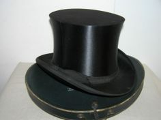 ANTIQUE SILK FOLDING HAT WITH HAT BOX.