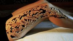 3-D tattoo.  The addition of shading and shadowing creates the illusion of a three-dimensional carving.