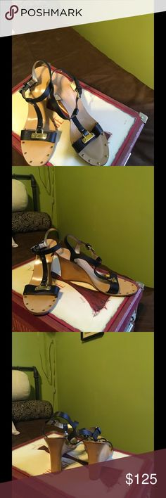 Kate Spade Kate Spade T Strap wedge Sandals. Black n color w/a natural wood heel and small accents of gold make this sandals transition for day to night ... 81/2B but ,I've measured the insole to b 10in. So I'm marking them a 71/2..31/2in wedge heel ,light wear.. I'm still wondering if I really want to let them go ... kate spade Shoes Wedges