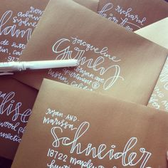 white ink hand lettering for kraft paper envelope addresses script typography handrawn cursive font calligraphy handmade invitations by laurenishdesign Calligraphy Letters, Typography Letters, Modern Calligraphy, Calligraphy Handwriting, Penmanship, Caligraphy, Font Alphabet, Cursive, Creative Lettering