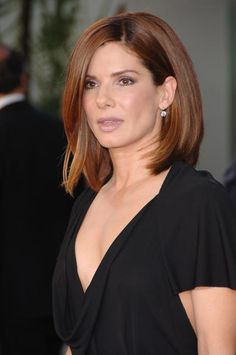The angled part and volume show off Sandra Bullock's medium length haircut to a T.