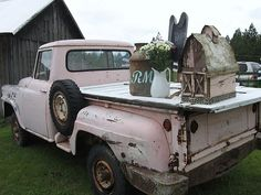 Pretty vintage pink truck,, truck love! could haul so many  more goodies! this from the girl who has 2 storage units full... uh oh... lol!