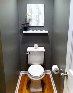 Déco peinture grise étagère blanche pour toilette chic.