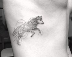 Detailed single needle wolf tattoo by Doctor Woo