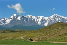 Landscape & Ethnic Photography from Mongolia, Altai and Tuva Off-road vehicle is riding in the Kurai Steppe. The North-Chuya Range. Altai Mountains. Russia