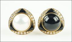 A PAIR OF DIAMOND, ONYX, AND 18 KARAT YELLOW GOLD EARCLIPS. Lot 150-7188 #jewelry