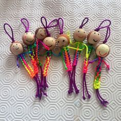 Darling little cord dolls - love the silky bead cord instead of clunky paracord.  Cute faces on the wooden heads.  No instructions on the link but it's an easy knot to copy.