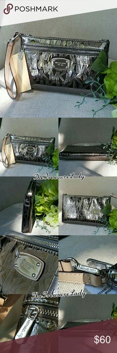"""Michael Kors Jet Set MK Wristlet clutch wallet *Authentic *NWT *Style # 35S6MTTW3Z *Mirrored Metallic Jet Set Large Wristlet, wallet, clutch *Nickel/Dark silver/Pewter color *Silver-tone hardware *Zipper closure *MK plaque on front *Measurements: 5"""" H x 8.25"""" L x 1"""" D *7"""" leather handle *Inside card holders and a slip pocket *An outer zipper compartment *UPC 190049116487 Please no trades, price is firm Same day shipping if order is placed by 3 p.m. EST Monday-Friday Contact…"""