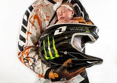 Dirt Bike Dad and Baby  The babys legs are crossed, with a receiving blanket wraped around her. Be careful not to hurt the baby. Help the Dad lift the baby while supporting the baby.   #dirtbike #dad #baby #babygirl #babyportraits #precious #beautiful #babyphotography #newborn #family #monster #monsterenergy #thor #thorgear #ktm #ktmusa #kombat #portrait #photography #motocross #helmet #canon #canonusa #bivinsphotography #bp #viewbugfeature #bigdaddy #boaz #Brooklyn