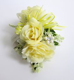 Faux Corsage - Wedding Corsage - Anniversary Corsage - Prom Corsage - Pale Yellow Roses Corsage - Mother's Day Corsage. $16.00, via Etsy.