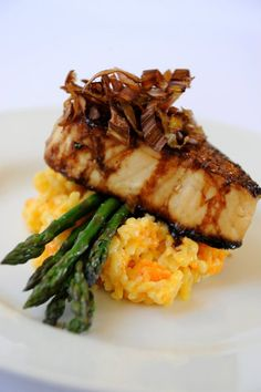 pan seared scallop in a balsamic reduction over a bed of roasted asparagus and cheesy risotto topped with carmalized onions.
