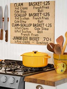 A vintage sign adds atmosphere to this cottage kitchen.